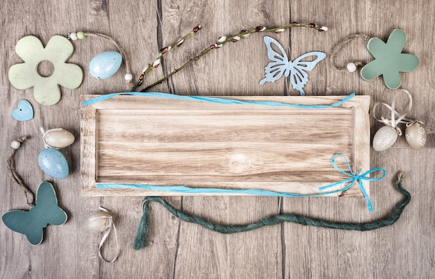 Wooden board on wood background with spring decodations Premium Photo