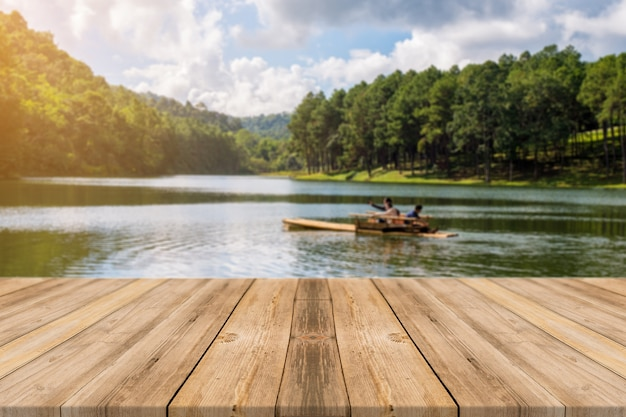 Wooden boards with a lake with a boat Free Photo