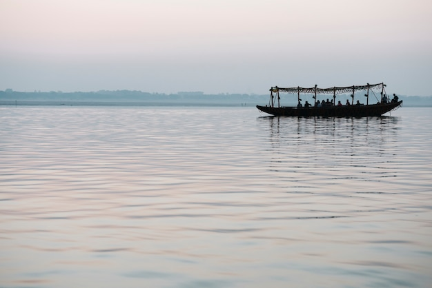 Wooden boat sailing on the river ganges in varanasi, india Free Photo