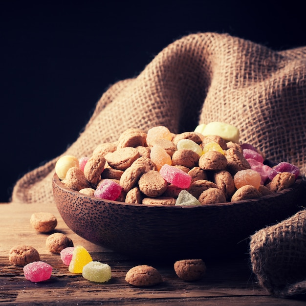Wooden bowl with typical dutch sweets for sinterklaas Premium Photo