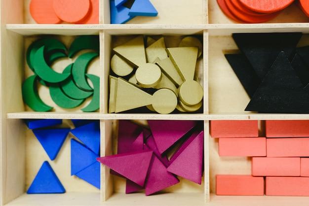 Wooden box with different materials in a montessori class. Premium Photo