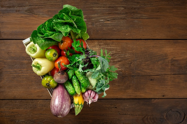 Wooden box with different vegetables harvesting Premium Photo