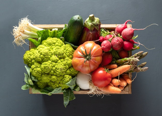 Wooden box with vegetables, high view Premium Photo