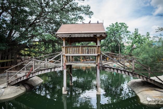 Wooden bridge across the river Premium Photo