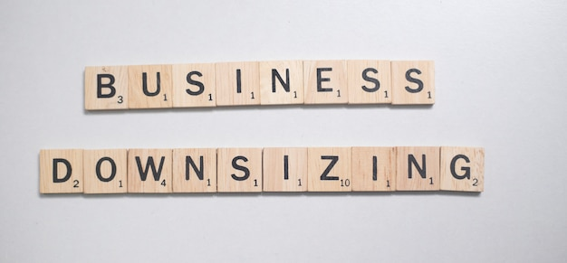 Wooden brown scrabble letter in business concept on white background Premium Photo