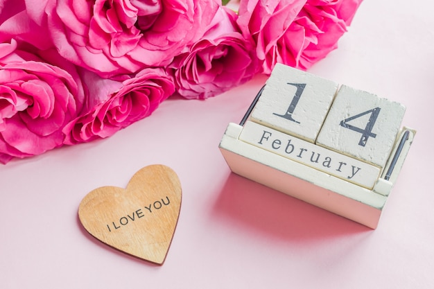 Wooden calendar with 14th february date Premium Photo