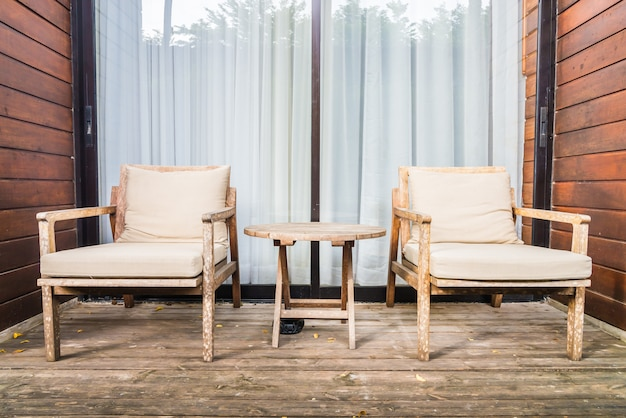 Wooden chair and table at outdoor terrace Free Photo