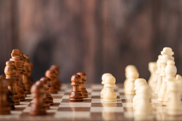 Wooden chess endways on the board Premium Photo