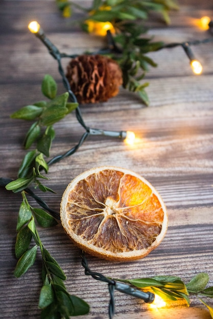 Wooden Christmas Background With Dried Orange Slice Boxwood Fir