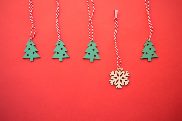 Wooden christmas toys, festive christmas decoration on the red background Premium Photo