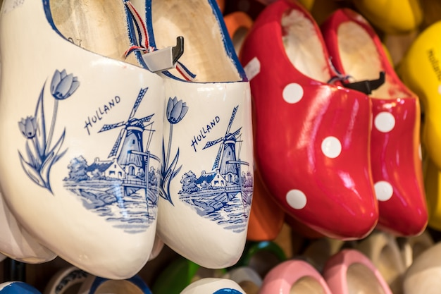 Wooden clogs with picture of windmill in souvenir store Premium Photo