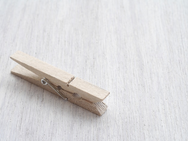Wooden cloth pegs on wood background Premium Photo