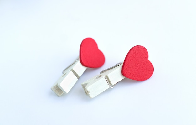 Wooden clothes pin or cloth pegs with heart shape design on