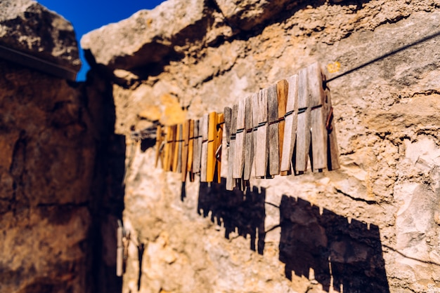 Wooden clothespins for hanging clothes with aged stone rural background. Premium Photo