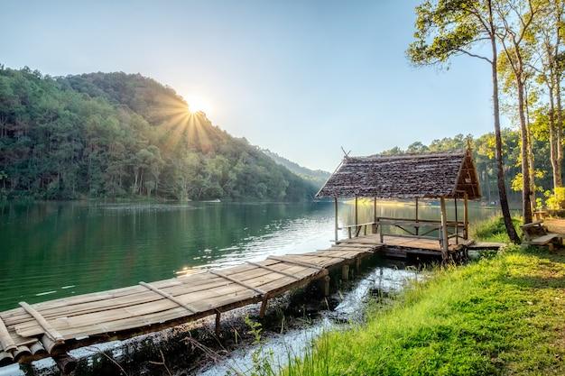 Wooden cottage on reservoir at sunset Premium Photo