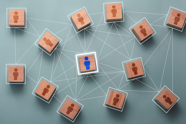Wooden cube block print screen person icon which link connection network for organisation structure social network and teamwork concept. Premium Photo