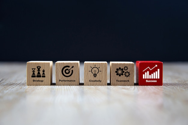 Wooden cube shape with business icons. Premium Photo