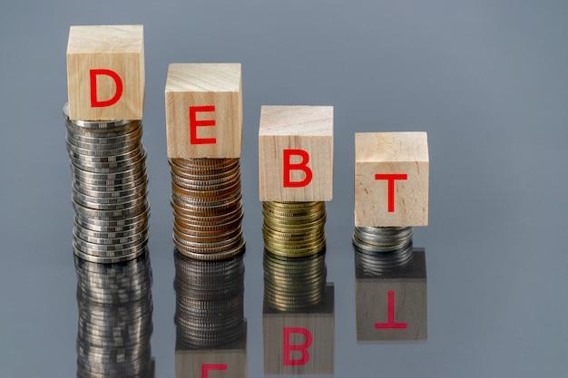Wooden cube text debt concept Premium Photo