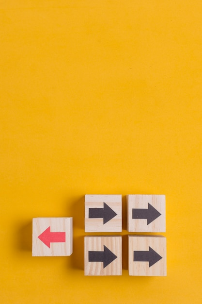 Wooden cubes with arrow on yellow copy space background Free Photo