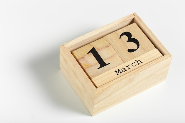 Wooden cubes with date on white. 13th of march Premium Photo