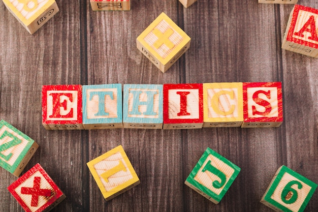 Wooden cubes with ethics title Premium Photo
