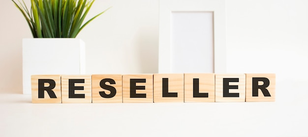 Wooden cubes with letters on a white table Premium Photo