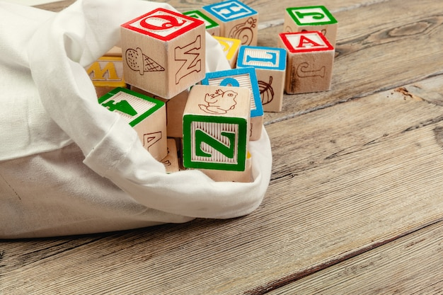Wooden cubes with letters on wooden background Premium Photo