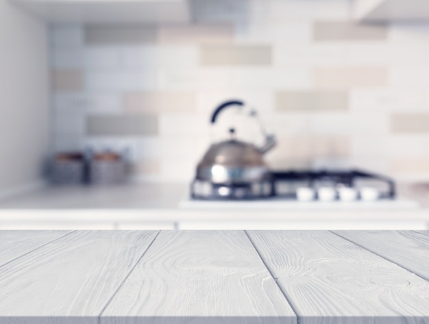Wooden desk in front of kitchen counter with blur modern gas stove top Free Photo