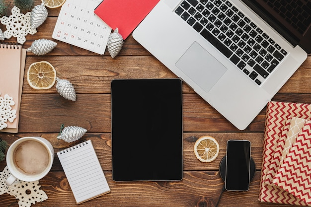 Wooden desktop with computer, office supplies and christmas decorations Premium Photo