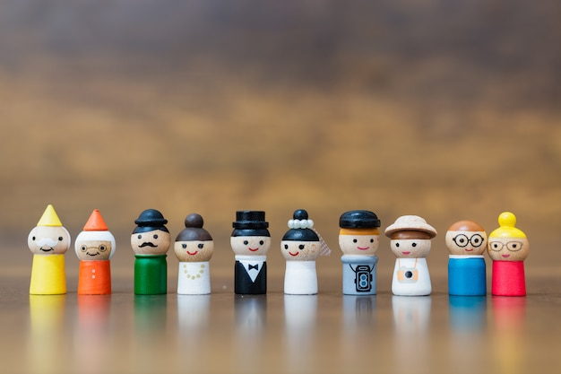 Wooden doll with  happy face on wooden background Premium Photo