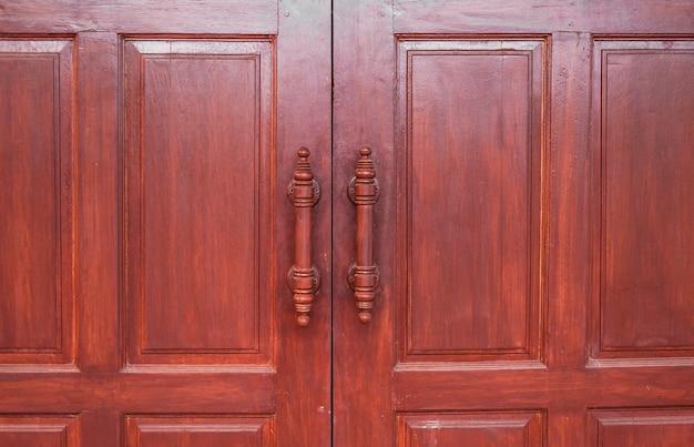 나무로되는 문 갈색 복고풍, 타이어 디자인 공예 문 프리미엄 사진