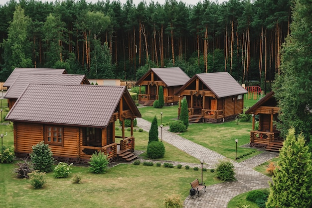 Wooden eco houses in the hotel near the pine forest Premium Photo