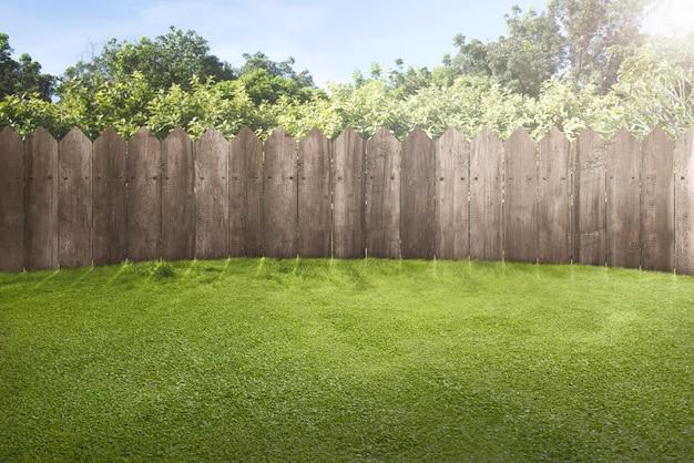 Wooden fence on green garden Premium Photo