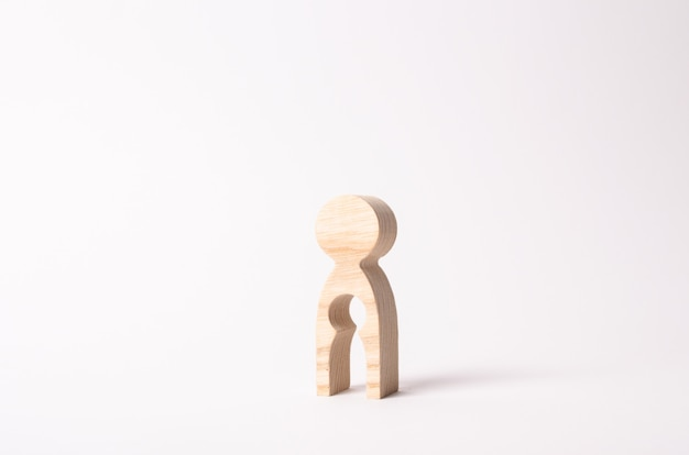 A wooden figure of a woman with a void inside in the shape of a child. Premium Photo