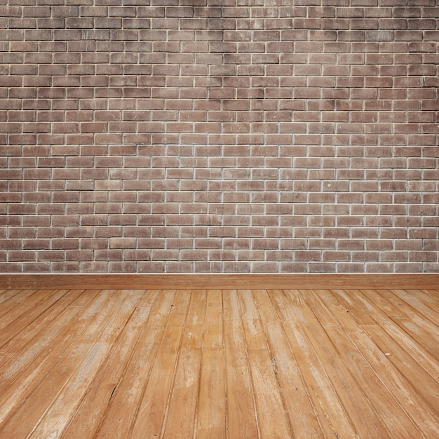 Wooden floor with brick wall Free Photo