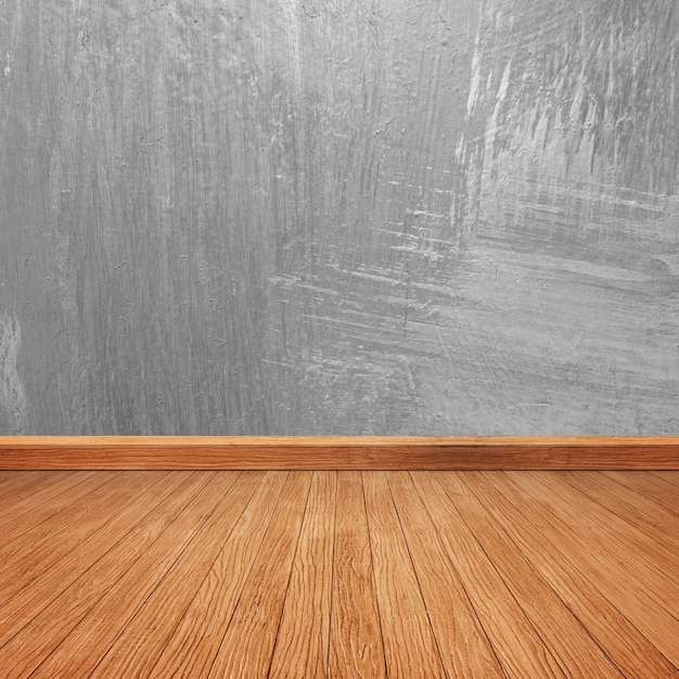Wooden floor with a concrete wall Free Photo