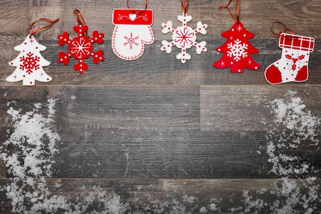 Wooden floor with snow and christmas decoration Free Photo