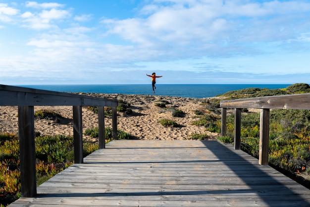 Wooden footbridge leading to shore. sunny day. Premium Photo