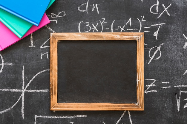 Wooden frame on blackboard with calculations Photo | Free Download