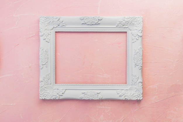 Wooden frame on pink table Free Photo