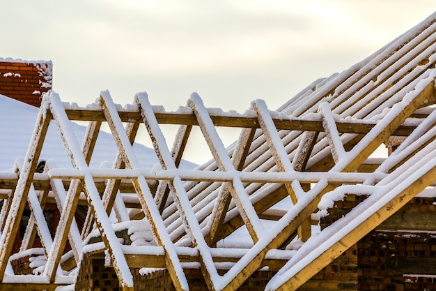 Wooden frame of the roof during construction works on a new house Premium Photo