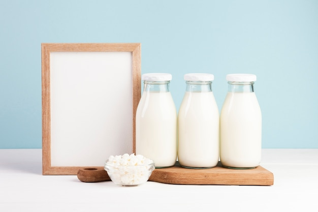 Wooden frame with bottles of milk Free Photo