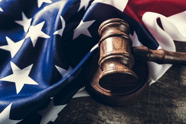 Wooden gavel and usa flag Premium Photo
