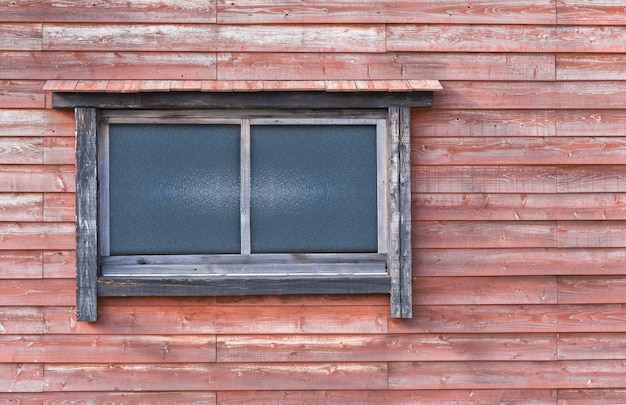 Wooden and  glass window in the redwood wall - image Premium Photo