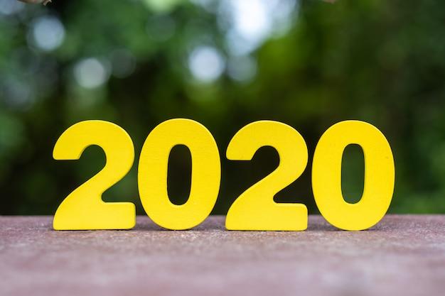 Wooden handmade 2020 numbers on table Premium Photo