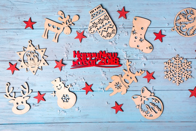 Wooden hanging toys and merry christmas greeting small red letters Premium Photo