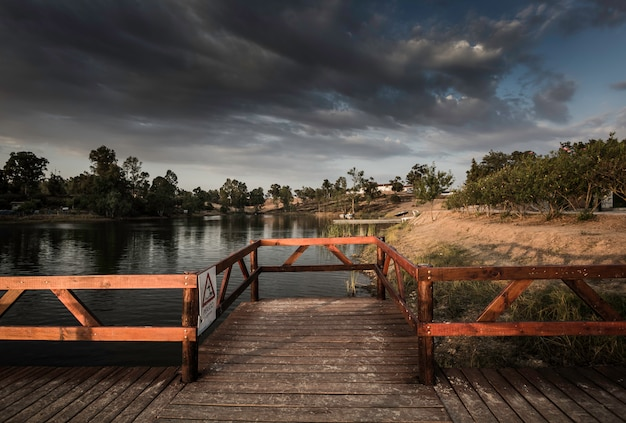 Wooden jetty and gazebo over the lake in sao domingos mine Premium Photo