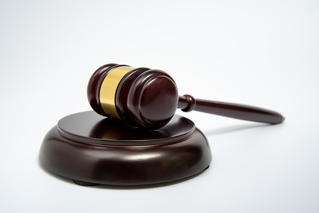 A wooden judge gavel isolated on white Premium Photo