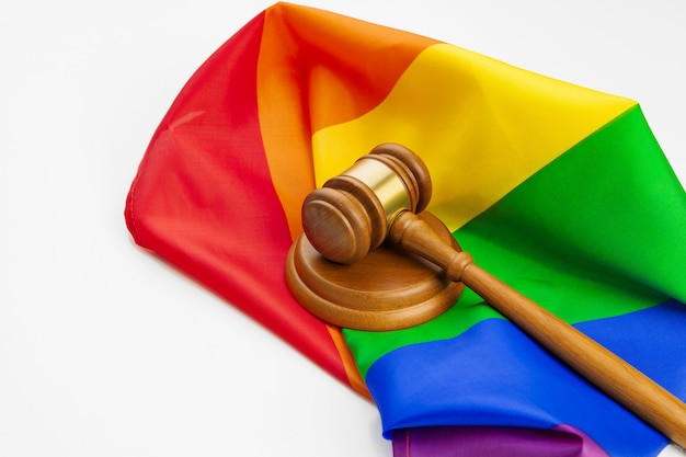Wooden judge mallet and lgbt rainbow flag Premium Photo