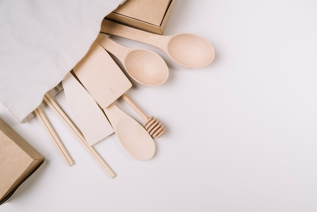 Wooden kitchen tools with copy space Free Photo